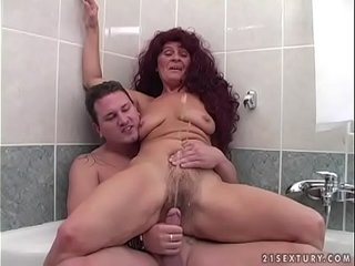 Chubby Granny enjoys pissing fuck