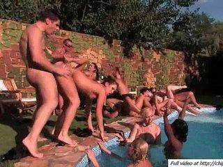 Sun group sex party near pool