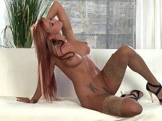 Hot redhead lingerie tease in sheer stockings